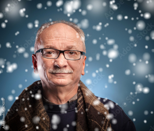 winter concept -  elderly man looks skeptically