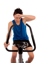 Exhausted after workout on exercise bike