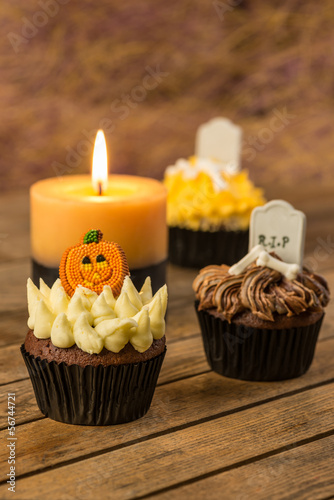 Halloween cupcakes and a burning candle close-up