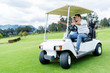 Players in a golf cart