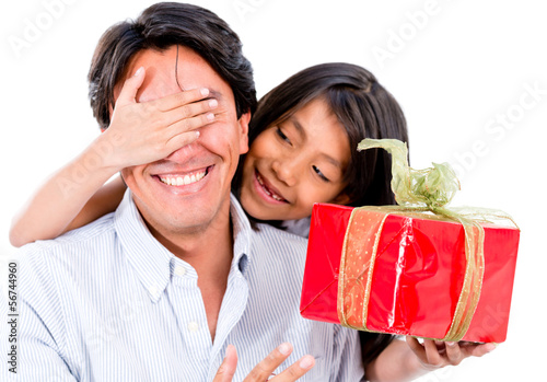 Girl giving father a present