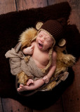 Yawning Newborn Baby Boy Wearing a Monkey Hat