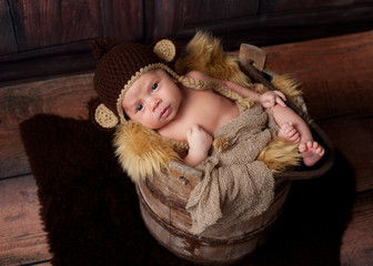 Alert Newborn Baby Boy Wearing a Monkey Hat