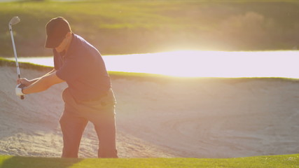Golfer Using Sand Wedge Bunker