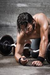 bodybuilder fine tuning his music player