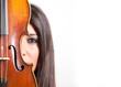 Young girl with violin against white background with copy space.