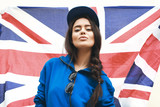beautiful young brunette woman with british flag