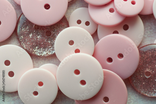 Close-up of assorted pink buttons