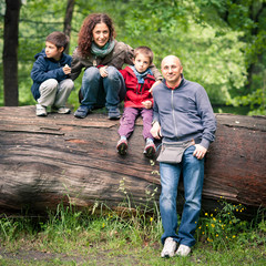 Happy family posing in a park.