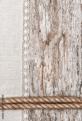 Linen fabric with lace and rope on the old wood