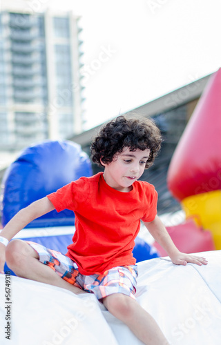 Child Playing in an Inflatable Playground