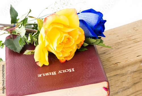 Flowers and Bible over a Cross
