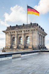 Reichstag in Berlin, with german flag