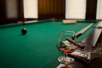 glass of cognac and billiards