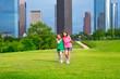 Two sister girls friends walking  in urban skyline