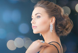 woman with diamond earrings - 56752922