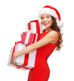woman in santa helper hat with many gift boxes