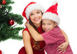 happy mother and child boy in santa helper hats