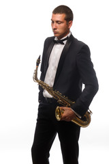 Isolated portrait of young saxophonist in suit with tie