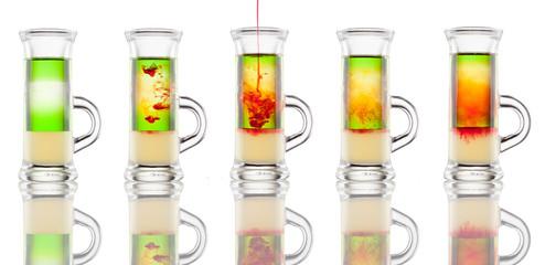 Multi-layered alcohol shot isolated on white