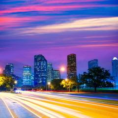 Houston Texas skyline at sunset with traffic lights