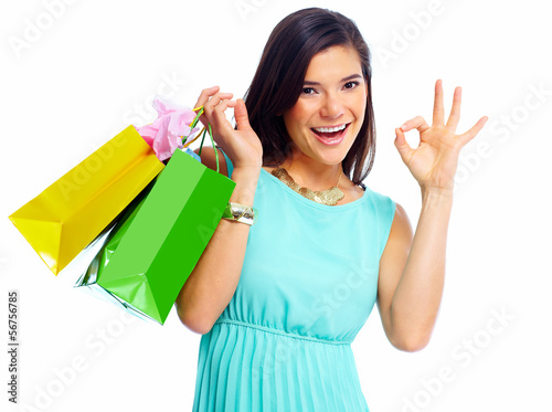 Happy shopping woman with bags.