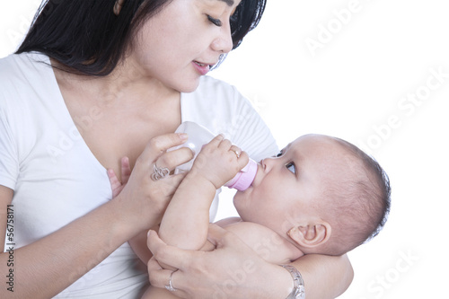 Close-up mother feeding baby - isolated