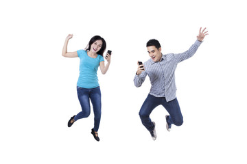 Excited couple with mobile phone