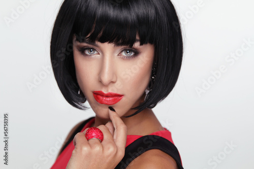 Sexy beauty brunette woman with Red Lips. Makeup. Stylish Fringe