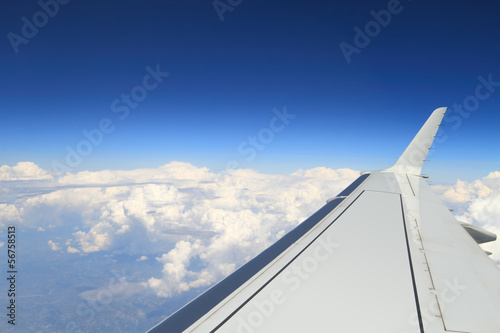 Aerial shot from airplane, with wing visible