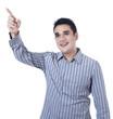 Smiling asian man pointing at something