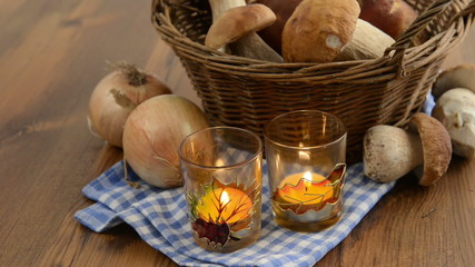 penny bun mushrooms in a basket and burning tea light