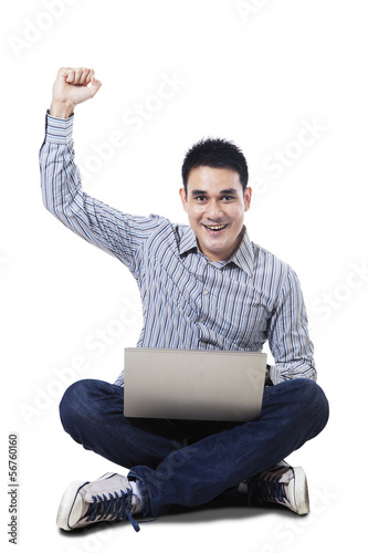 Successful online man with laptop