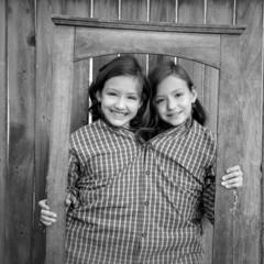 twin girls fancy dressed up pretending be siamese in frame