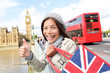 London tourist woman holding shopping bag, Big Ben