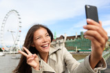 Asian tourist in London taking self-portrait photo