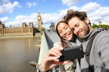 London tourist couple taking photo near Big Ben