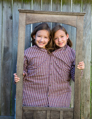 twin girls fancy dressed up pretending be siamese in frame