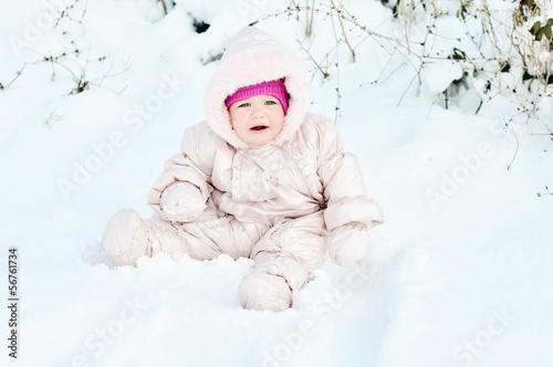 baby  sitting in snowdrift