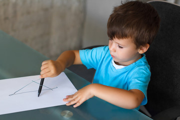 Preschooler boy learn writing letters