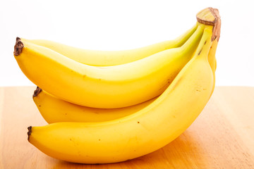 Bunch of Bananas on Wood Table with White Background