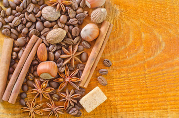 coffee and aroma spice on wooden background