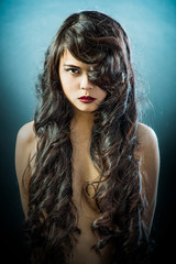 Beautiful brunette Asian woman with long black hair