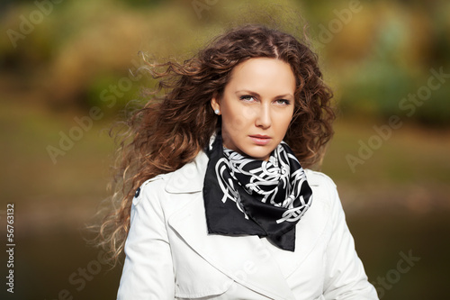 Beautiful woman in white against autumn nature background