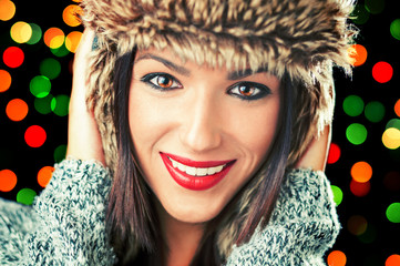 Beautiful christmas girl with fur hat smiling