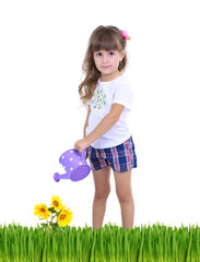 Little girl watering beautiful flowers and grass isolated