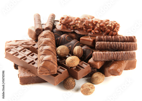 Delicious chocolate bars with nuts isolated on white