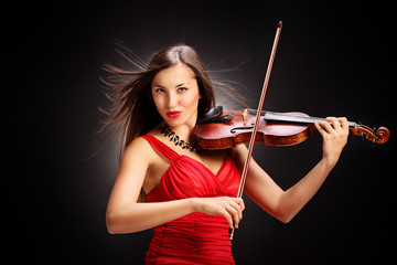 Young woman in red dress playing the violin