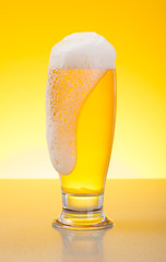 Overflowing pale lager beer