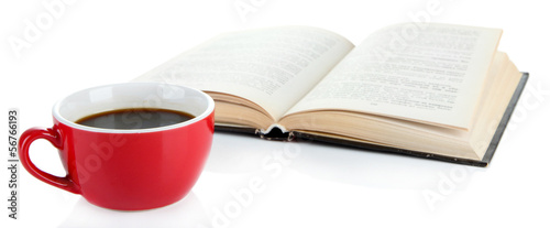 Cup of coffee and interesting book isolated on white